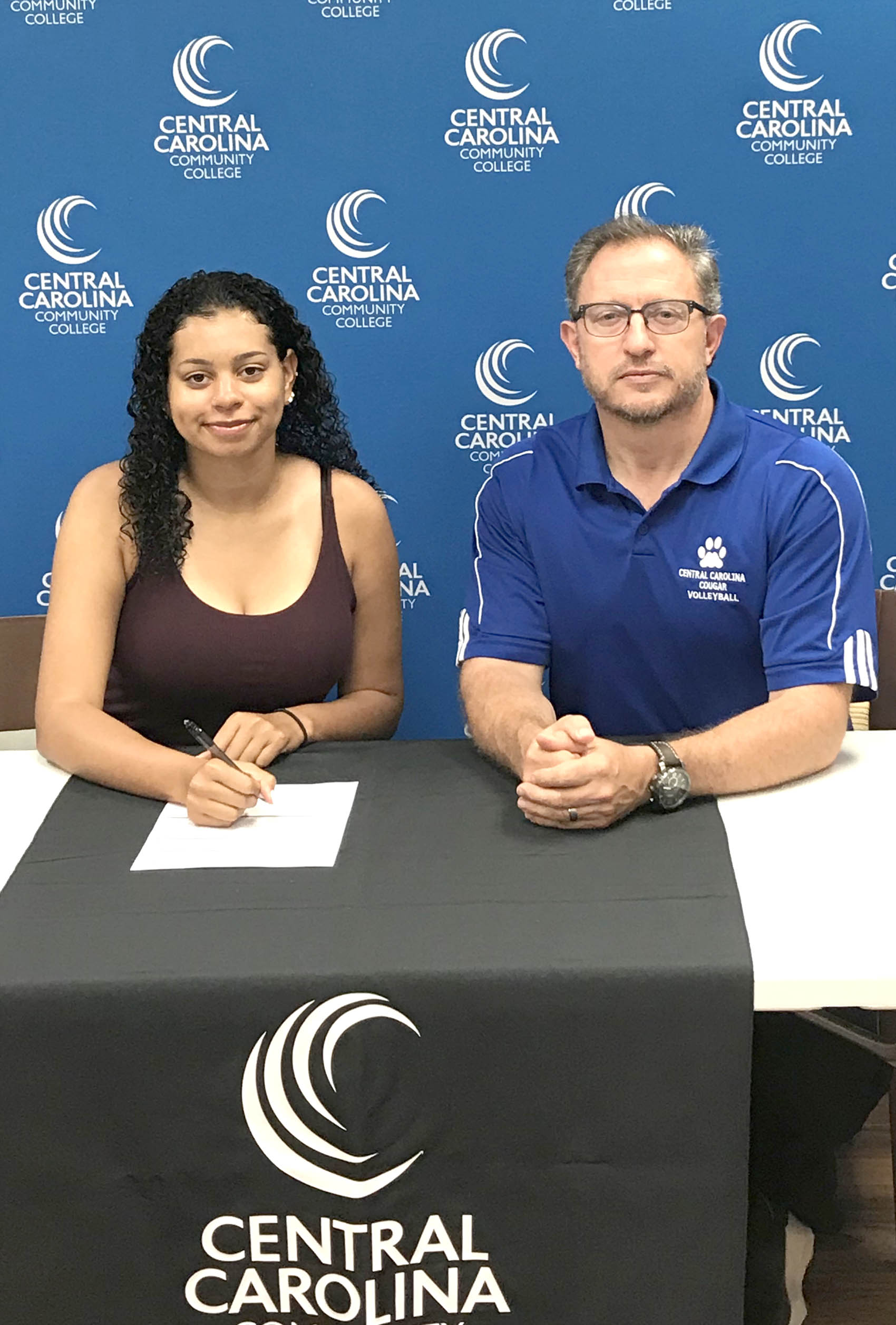 Click to enlarge,  Kayla Stange (left), who attended Overhills High School in Harnett County, will join the CCCC volleyball program. She is pictured with CCCC Volleyball Coach Bill Carter (right).
