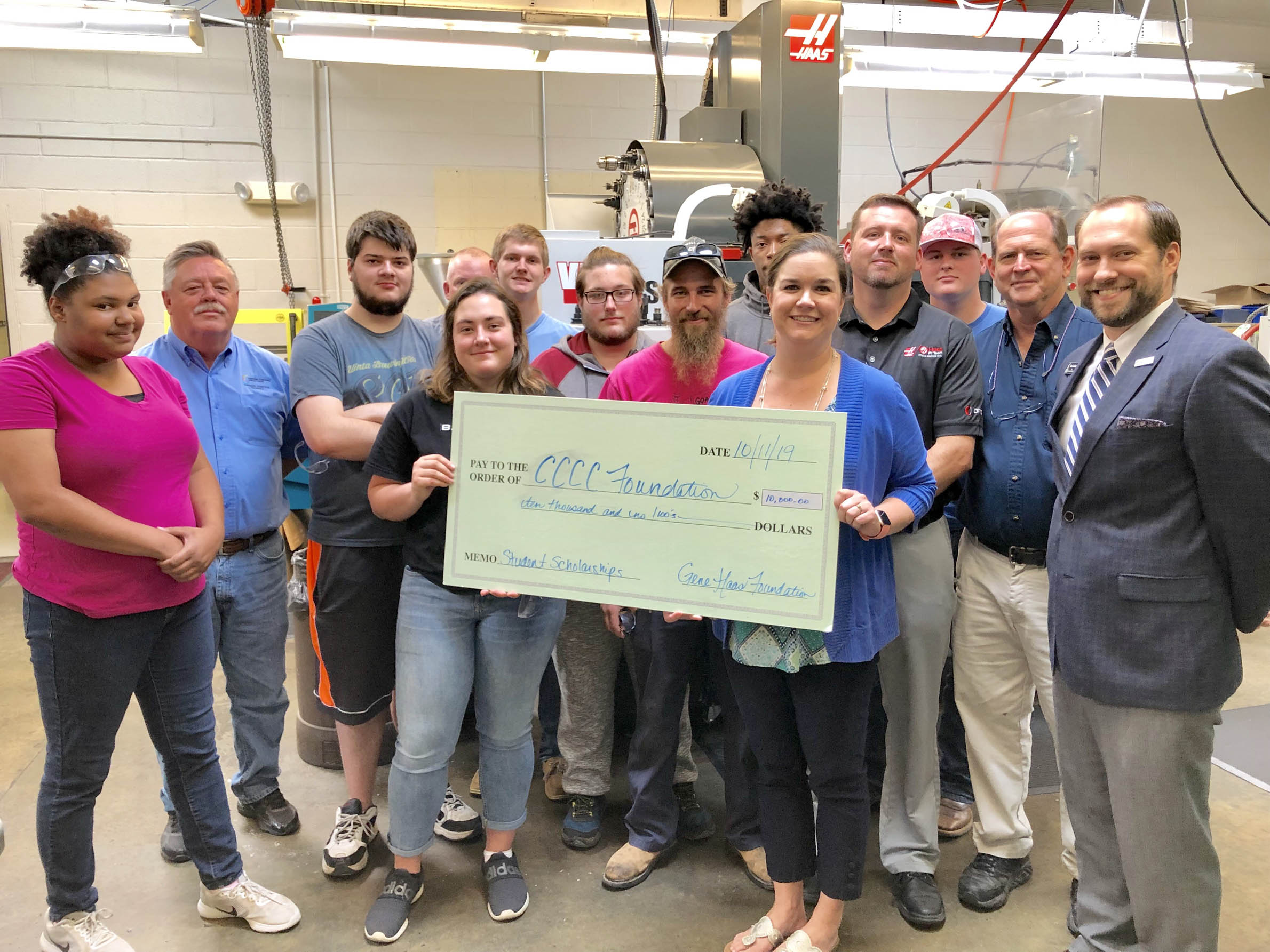 Click to enlarge,  Students, faculty, and staff involved in Central Carolina Community College's Computer Integrated Machining program are thankful to the Gene Haas Foundation for providing $10,000 in scholarship support to the program. Presenting the check to the college was Bill Cranford, Sales Engineer with Haas Factory Outlet, a division of Phillips Corporation.