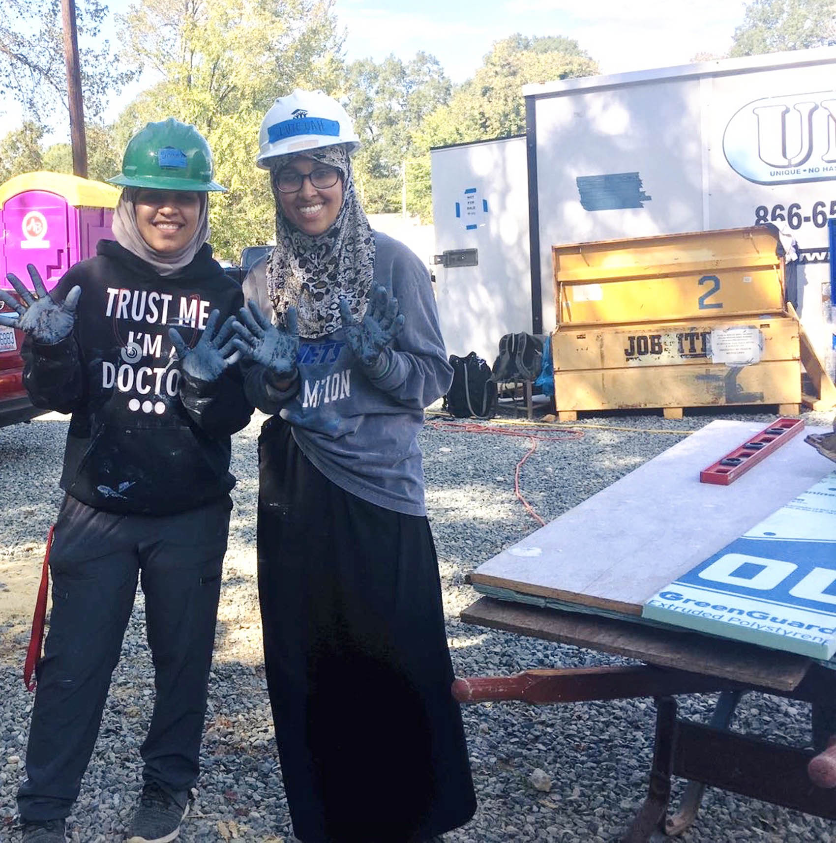 Click to enlarge,  Two Central Carolina Community College students -- Lutfiah Alwahishi and Shaimaa Ali -- recently participated in the Tar Heel Service Day event. They assisted in the work of the Chatham Habitat for Humanity program.