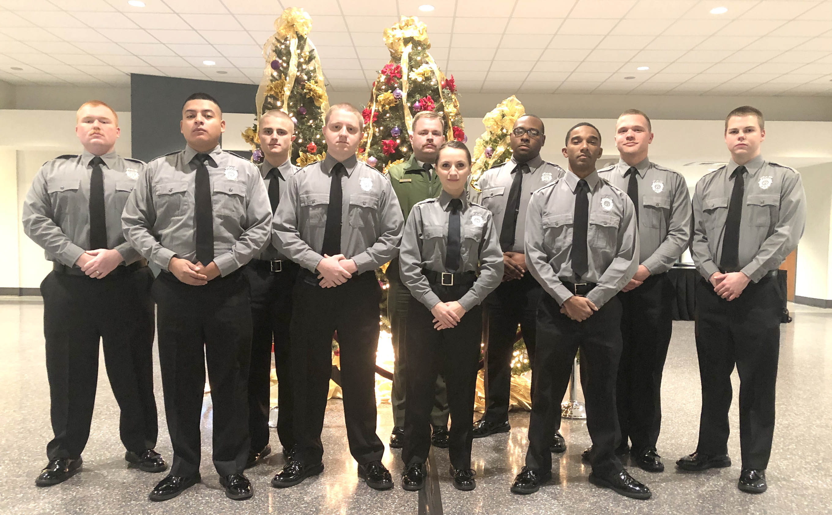 Click to enlarge,  Pictured are members of Central Carolina Community College's Basic Law Enforcement Training (BLET) graduating class -- (left to right), front row, Isael Dominguez, John Thomas, Alyona Eakes, and Corey Smith; back row, Steven Nordlof, Zachary Hayes, Spencer Williams, Joshua Elliott, Philip Hanson, and Mathew Bell. For more information about the college's BLET program, visit www.cccc.edu/blet or contact Robert Powell at rpowell@cccc.edu or 919-777-7774.