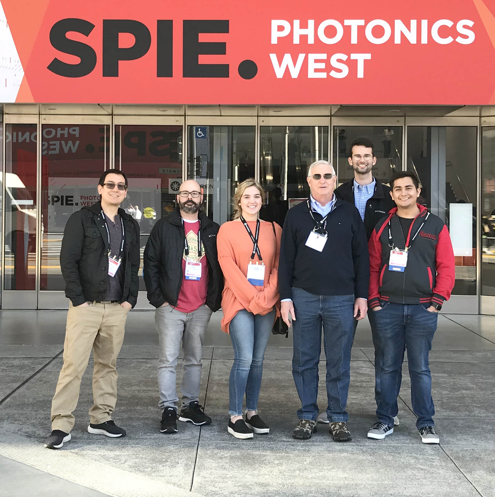 Click to enlarge,  Second-year students in the Laser and Photonics Technology program at Central Carolina Community College attended the 2020 SPIE Photonics West Convention in San Francisco. Previous CCCC Laser graduate Al Delong also attended the convention.  Pictured are, left to right: Al Delong, John Brooks, Cassidy Harris, Gary Beasley (Lead Instructor), Xan Bayles, and Angel Gonzalez-Aguilar.