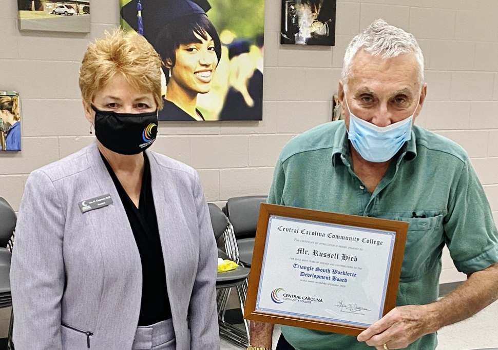 Click to enlarge,  Central Carolina Community College President Dr. Lisa M. Chapman (left) presents a certificate of appreciation to Russell Hieb for his many years of service and contributions to the Triangle South Workforce Development Board.
